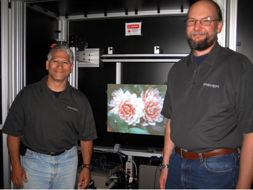 Prysm engineers David Kindler (left) and Dave Kent at the final panel tester assembly.