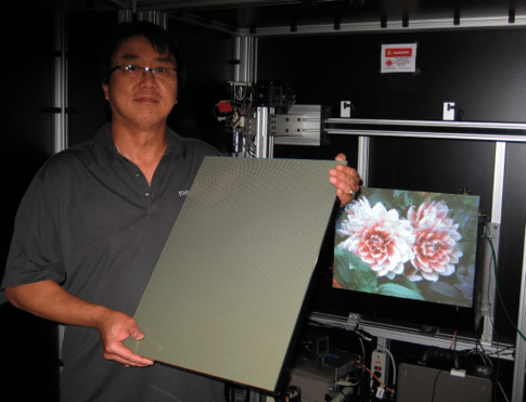 Patrick Tan holding a finished 25-inch LPD panel