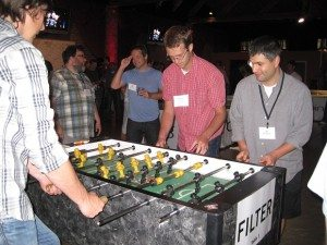 Foosball game at the Tech Flash Summer BBQ & Ping-Pong Tournament