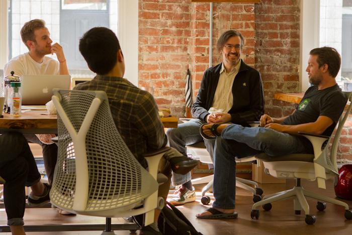 Discussions inside Greenstart founders discuss product challenges with design partner David Merkoski (far right).