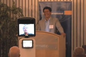 Yulun Wang of InTouch Health and Colin Angle of iRobot (speaking via the RP-VITA telepresence robot)