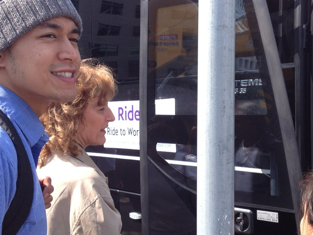 Happy commuters board a Ridepal bus.