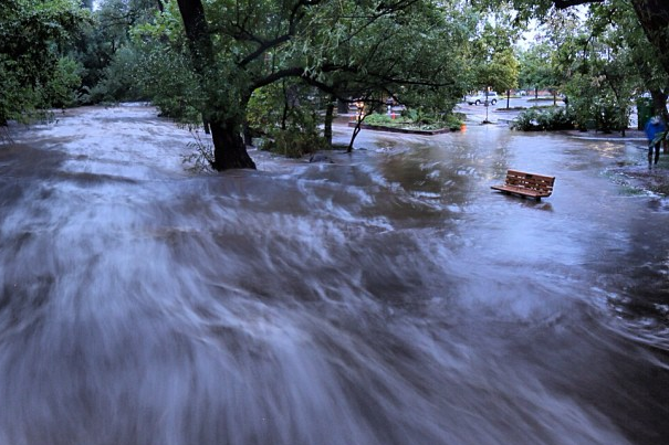 Downtown Boulder, CO, was hit by record rainfall last week and over the weekend, which created a 100-year flood that devastated parts of the city and surrounding communities. The flood inundated the park along Boulder Creek, which runs through the downtown. Photo by Jud Valeski.
