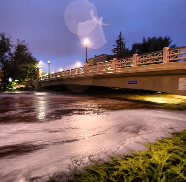 Low Clearance—The flooded Boulder Creek reached nearly reached the road deck of this bridge in downtown Boulder, CO. The storm dropped 17.1 inches of rain and created a 100-year flood. Photo by Jud Valeski.