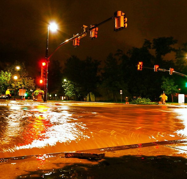 Record rainfall created a 100-year flood in Boulder, CO, and surrounding cities. This photo shows flooding at the intersection of Canyon Boulevard and Broadway in downtown Boulder. Photo by Jud Valeski.