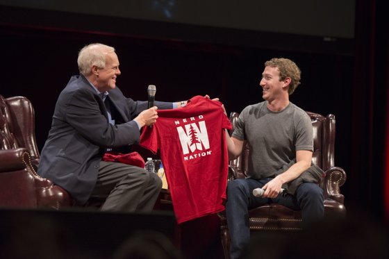 """Stanford president John Hennessy presents Facebook CEO Mark Zuckerberg with a """"NerdNation"""" t-shirt as a memento of his visit. Linda Cicero 