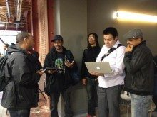 Derrick Johnson (left) chats with fellow participants at Startup Weekend Oakland. Photo courtesy of Adam Stiles.