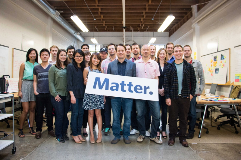 "The ""Matter Three"" class of startup founders. Corey Ford is at center, holding the sign."