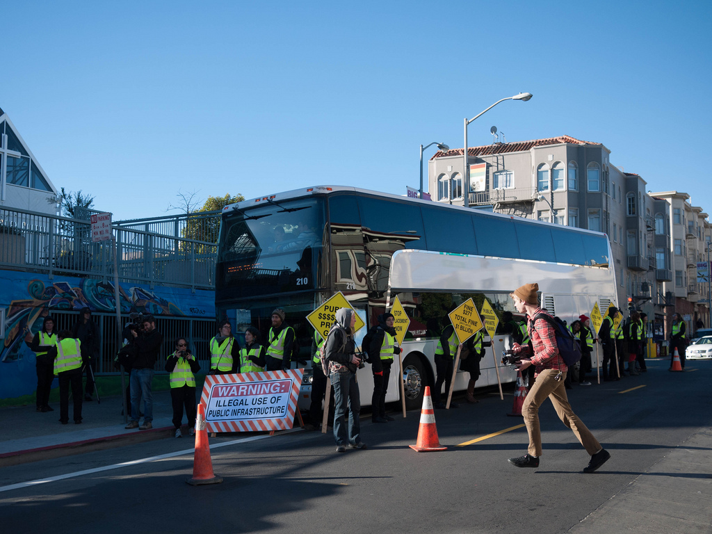 Protesters blockade a Google bus near the corner of 24th and Valencia in San Francisco. Source: Chris Martin/Flickr