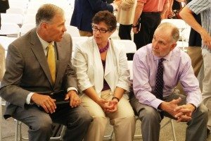 Cauce, center, talks with Gov. Jay Inslee, left, and Young, at a UW startup celebration in 2014.