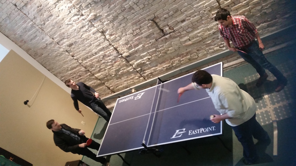 Scanalytics employees play ping-pong in the startup's Milwaukee office. Photo courtesy of Scanalytics.