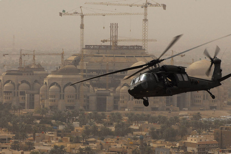 A UH-60 Black Hawk from Task Force 34, 1st Battalion 244th Assault Helicopter Battalion flies over a mosque during a routine flight on Feb. 27, 2009