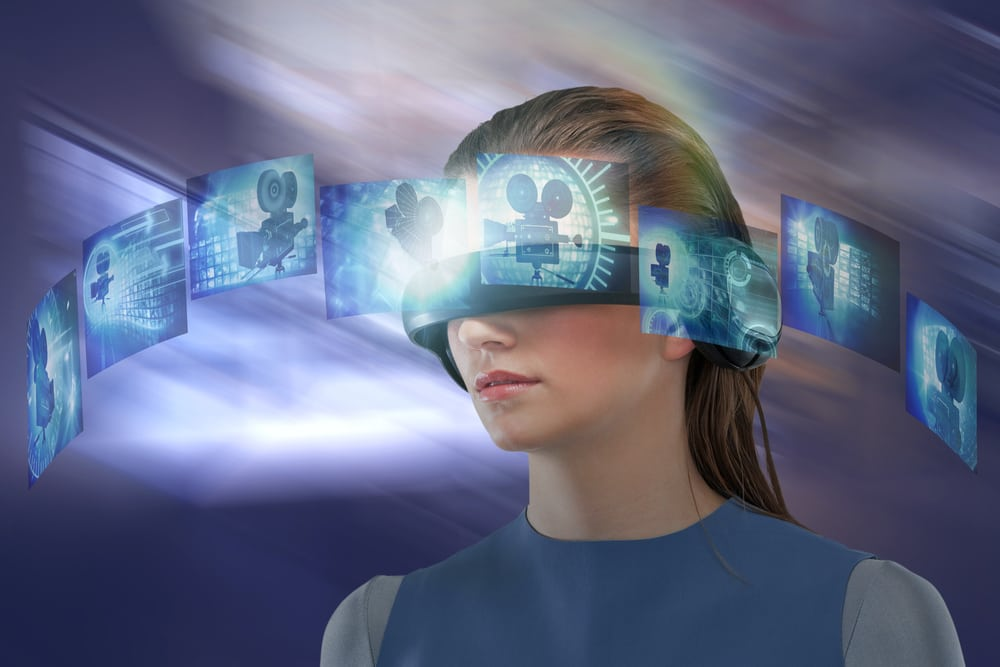 Composite image of woman experiencing  virtual reality headset