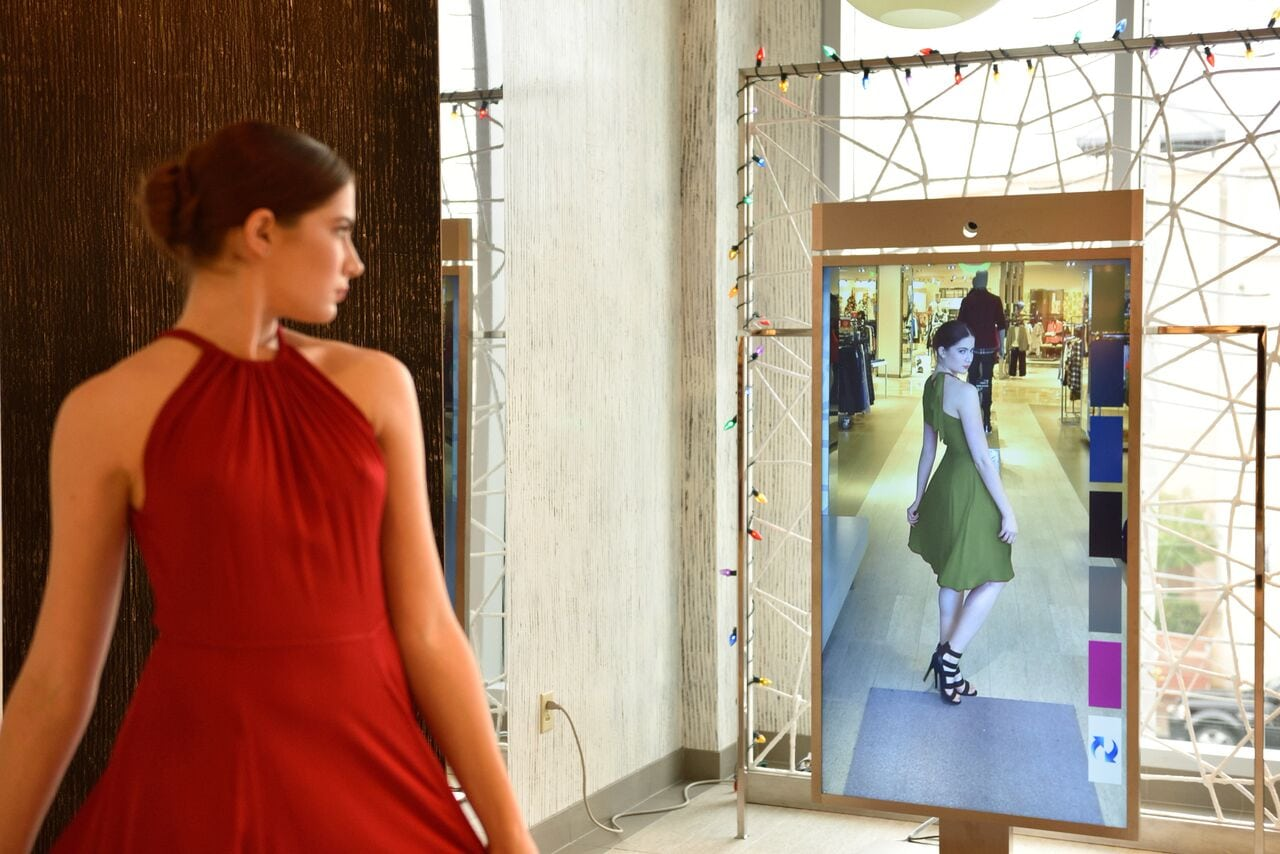 The mirror can show shoppers clothing in different colors using augmented reality. (Photo courtesy: Memomi)