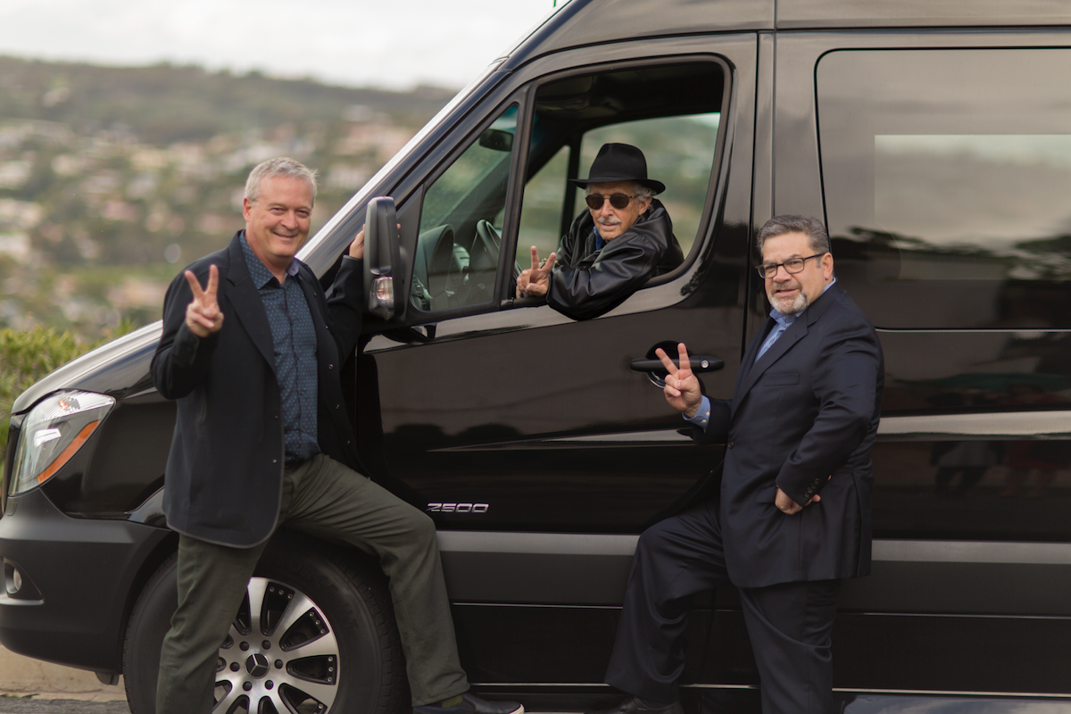 """From left, the """"VCs in a Van"""" crew - Mark Bowles, Neil Senturia (in van) and Tom Tullie - poses for a photo."""