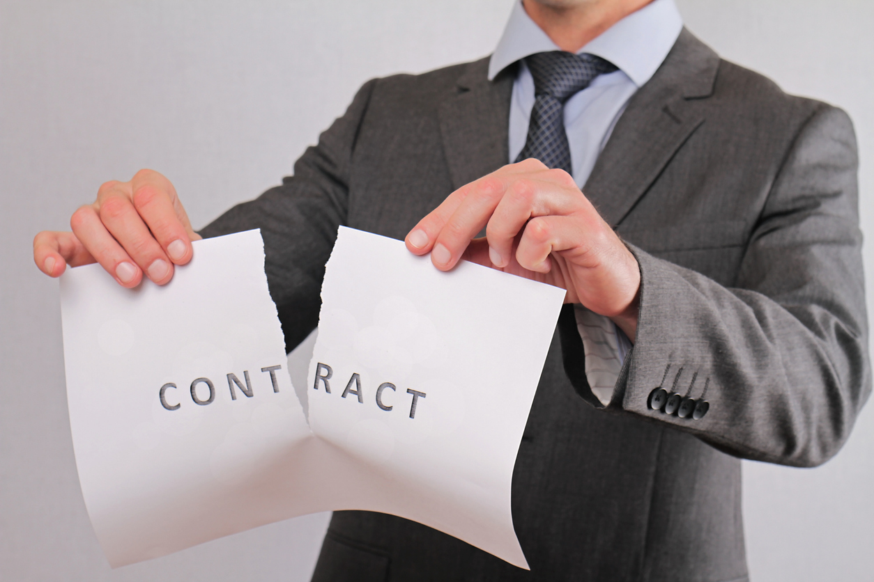 Businessman breaking contract close up. Termination of Contract