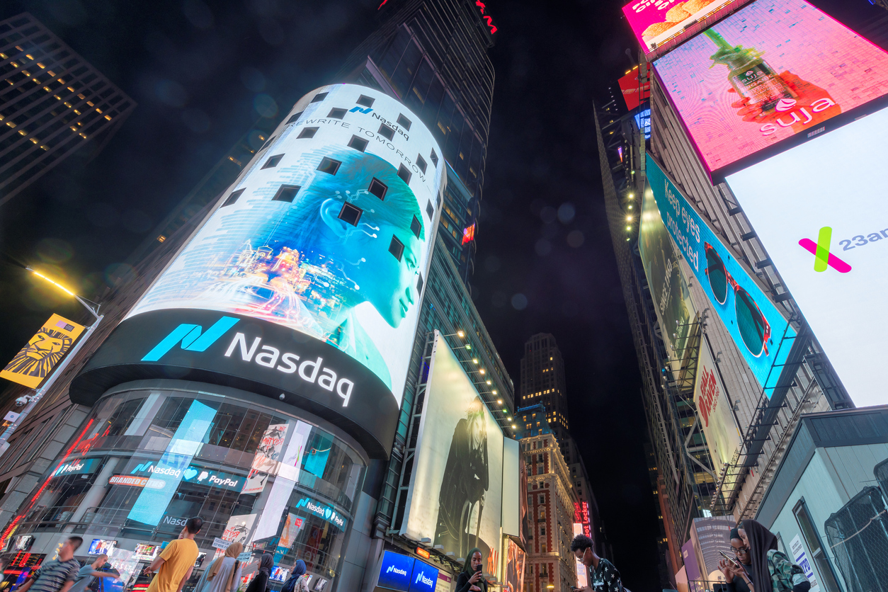 NASDAQ building at night in Time Square