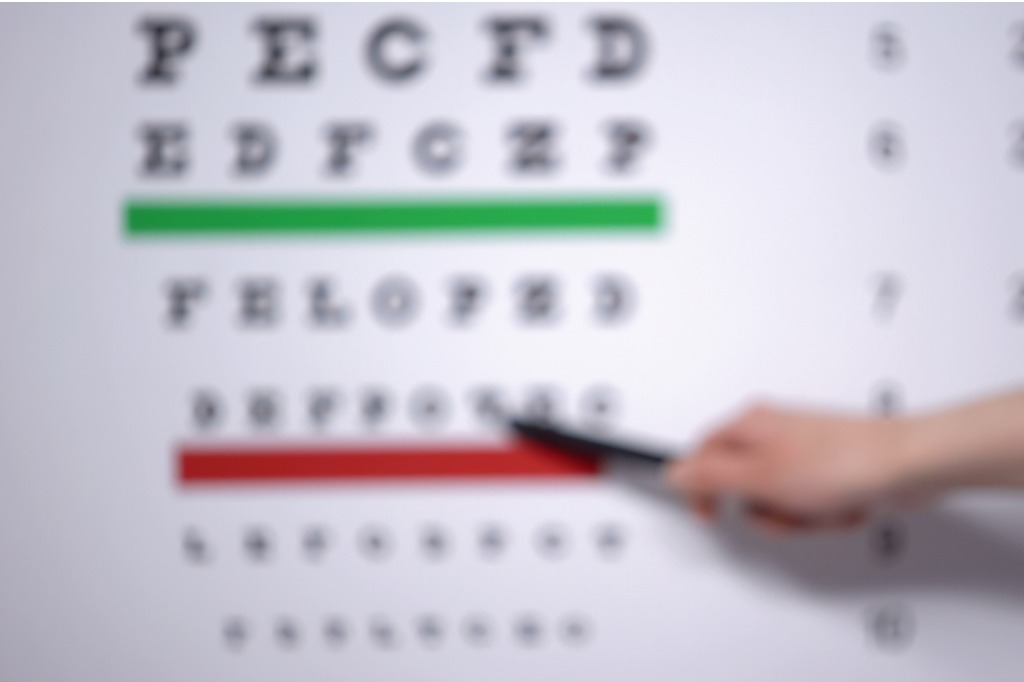 ophthalmologist-hand-showing-letter-on-eye-chart-to-patient-with-picture-id1170896710