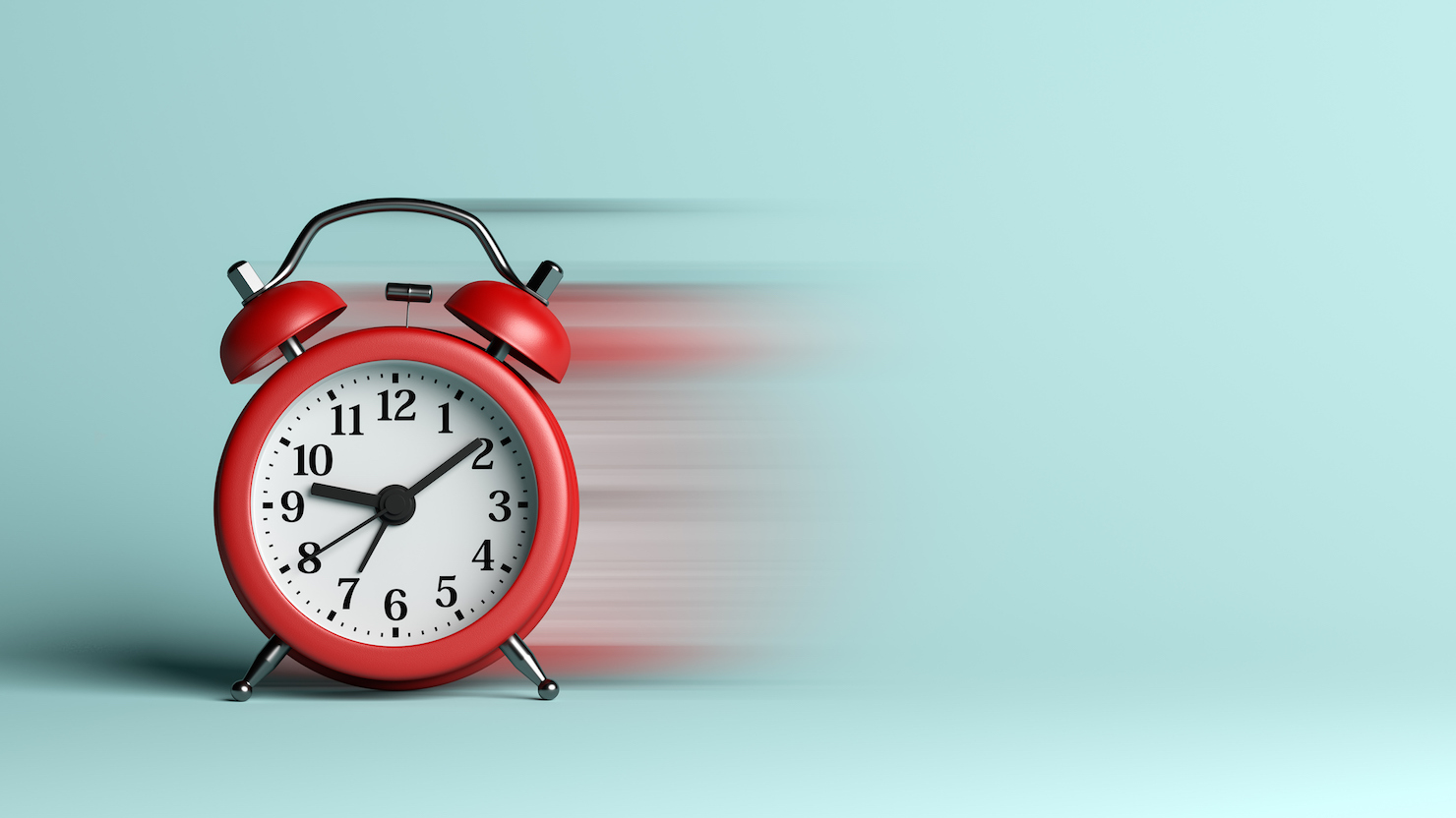 Red Alarm Clock with Blur Effect on Blue Background