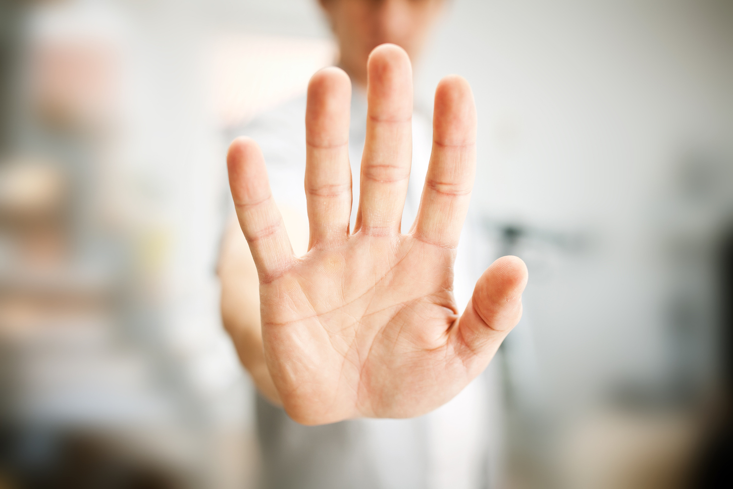 Man performing stop gesture with hand